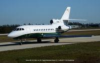 N111MU @ APF - Falcon 900 taxiing to take off. - by J.G. Handelman