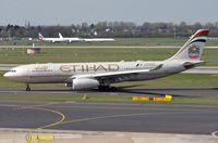 A6-EYM @ EDDL - Etihad A332 vacating the runway - by FerryPNL