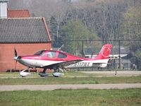 N117MX @ EHSE - cirrus taxing to the runway - by fink123