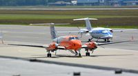 D-CFMD @ LOWG - Beech 300 King Air at LOWG with a Piaggio P.180 in the background - by Paul H