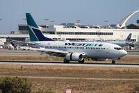 C-FWCN @ LAX - West Jet
