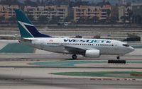 C-GEWJ @ LAX - West Jet - by Florida Metal