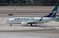 C-FEWJ @ KLAS - Boeing 737-700 - by Mark Pasqualino