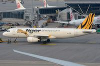 9V-TAZ @ VHHH - Tigerair A320 still in original Tiger Airways livery including the tiger. - by FerryPNL