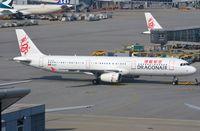 B-HTH @ VHHH - Dragonair A321 pushed back. - by FerryPNL