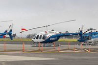 N1085T @ OXR - 1980 Bell 206L-1 LongRanger II, one Allison 250-C28B TurboShaft 500 shp, LongRanger II introduced in 1978-this is a II, on Aspen Helicopters ramp - by Doug Robertson