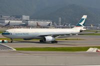 B-LAG @ VHHH - Cathay A333 under tow - by FerryPNL