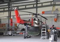C-FPQA @ CYXU - maintenance hangar - by olivier Cortot