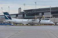 C-GWEG @ CYOW - DHC-8-402 - by Mark Pasqualino