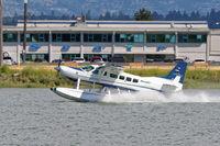 C-FJOE @ CYVR - Departing float base - by Guy Pambrun
