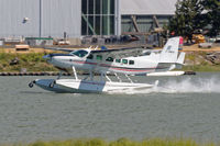 C-GNFN @ CYVR - Landing at the float base - by Guy Pambrun