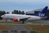 LN-RPA @ ENGM - SAS, braking on landing - by Jan Buisman