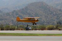 N98661 @ SZP - 1946 Piper J3C-65 CUB, Continental A&C75 75 Hp upgrade by STC, landing Rwy 22L grass - by Doug Robertson
