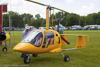 N31419 @ KOSH - Robinson R44 Raven II  C/N 11381, N31419