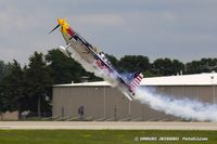 N669RB @ KOSH - Red Bull Air Race pilot, Kirby Chambliss take off, N669RB