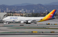 DQ-FJL @ KLAX - Being towed to a parking lot to free up a gate at LAX. - by Dave Turpie