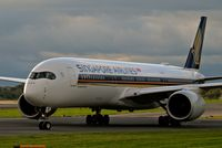 9V-SMI @ EGCC - taxing in to its gate/stand. - by andysantini