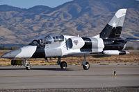 N136EM @ KBOI - Taxiing on Foxtrot.  Black Diamond Jet Team.