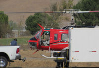 N931CH @ O69 - Pilot of Heligroup Fire LLC (Missoula, MT) shutting down 1972 Bell 205A-1 after returning to Petaluma Municipal Airport, CA temporary home base from making water drops on the devastating October 2017 Northern California wildfires - by Steve Nation