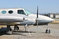 N821KB @ E16 - Locally-based 1966 Cessna 411 parked and rotting on the ramp at San Martin Airport, CA.