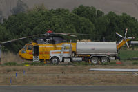 N1043T @ O69 - Croman Corp (White City, OR) 1982 Sikorsky S-61A behind fuel truck at the Petaluma Municipal Airport, CA temporary home base used by fleet of CALFIRE contracted helicopters to make water drops on the devastating October 2017 Northern California wildfires - by Steve Nation