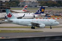 C-GITR @ EGLL - Air Canada A319 taxying out for departure in LHR. - by FerryPNL