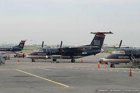 N824EX @ KLGA - De Havilland Canada DHC-8-106 Dash 8  C/N 387, N824EX