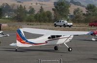 N422RT @ O69 - Colorful Montana-based 1977 Cessna 180K @ Petaluma Municipal airport, CA - by Steve Nation
