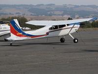 N422RT @ O69 - Colorful Montana based 1977 Cessna 180K @ Petaluma Municipal Airport, CA - by Steve Nation