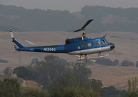 N1206G @ O69 - Trans Aero (Cheyenne, WY) 1966 UH-1H water dropping helicopter hovers @ Petaluma Municipal Airport, CA temporary home base in support of efforts to control devastating Oct 2017 Northern California wildfires - by Steve Nation