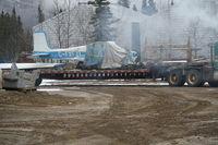 C-FXFZ - The wreckage of C-FXFZ being removed from behind the gas station at Macrae, along the Alaska Highway in Whitehorse, Yukon. - by Murray Lundberg