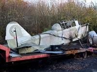 BAPC395 @ EGTB - Pilatus P-2/05 replica now in yard next to Parkhouse Aviation, Wycombe Air Park.