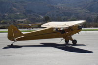 N98425 @ SZP - 1946 Piper J3C-65 CUB upgraded to Continental C90 90 Hp, taking the active Rwy 04 - by Doug Robertson