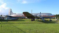 N381AA @ EVB - DC-7BF