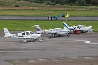G-CDYC @ EGFH - Resident Cherokee Arrow IV seen with visiting aircraft.