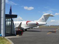 N1350S @ NZAA - At AKL -shame partly hidden behind executive terminal - by magnaman