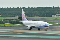 B-18652 @ RJAA - Taxiing in to Narita International on a cloudy day.
