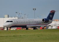 N244PS @ DAY - PSA Airlines Canadair Regional Jet CRJ-200ER {N244PS}, operating as U.S Airways Express, heads towards Runway 24 Left at the Dayton International Airport {DAY} bound for the Charlotte/Douglas International Airport on June 21, 2015. - by Rollie Puterbaugh 2015