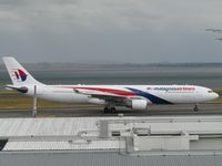 9M-MTA @ NZAA - taxying to stand - by magnaman