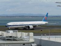 B-2009 @ NZAA - turning off runway - by magnaman