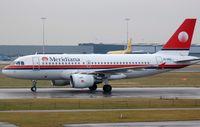EI-DEZ @ EHAM - Meridiana A319. Airframe broken up in 2014. - by FerryPNL