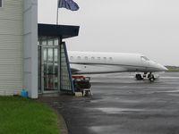 N317LL @ NZAR - hiding behind exec terminal - by magnaman