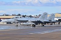 "168774 @ KBOI - Two EA-18Gs from VAQ-131 ""Lancers"", CVN-77, USS George H.W. Bush parked on the south GA ramp for a fuel stop. - by Gerald Howard"