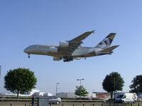 A6-APB @ EGLL - Landing runway 27L at Heathrow airport EGLL - by Marc Mansbridge