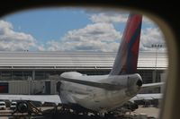 N669US @ DTW - Delta 747 at the gate taken from the upper deck of the 747-400 I am in