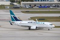 C-FWSI @ KFLL - Boeing 737-700 - by Mark Pasqualino