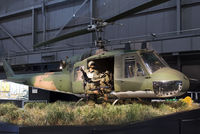 """64-15476 @ KFFO - Huey '492' is painted to represent a 20th Special Operations Squadron """"Green Hornets"""" helicopter that rescued a seven-man team of Green Berets on Nov. 26, 1968 in Vietnam.  The pilot, 1st Lt. J. Fleming was awarded the Medal of Honor for the mission."""