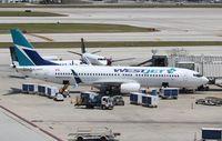 C-GNDG @ KFLL - Boeing 737-800 - by Mark Pasqualino