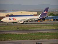 N663FE @ KBOI - Take off run on RWY 10L. - by Gerald Howard