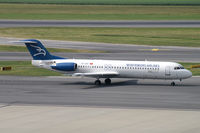 4O-AOP @ VIE - Montenegro Airlines Fokker 100 - by Thomas Ramgraber
